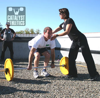 Lani instructing the deadlift at the Stone Clinic seminar about a million years ago. We miss you Lani! - Olympic Weightlifting, strength, conditioning, fitness, nutrition - Catalyst Athletics