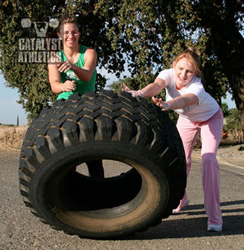 Team tire flipping. - Olympic Weightlifting, strength, conditioning, fitness, nutrition - Catalyst Athletics